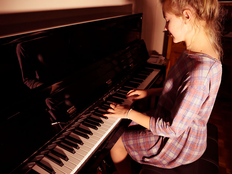 Teenager playing the piano
